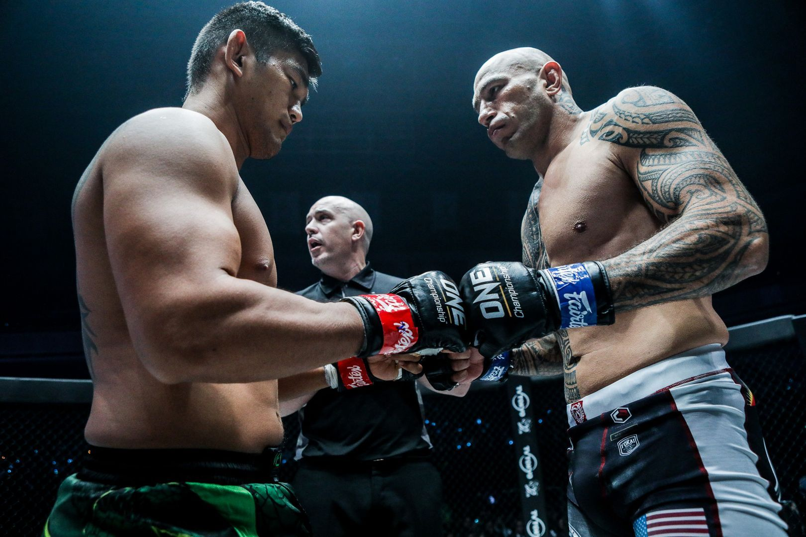 Aung La N Sang and Brandon Vera touch gloves before their battle in Tokyo, Japan