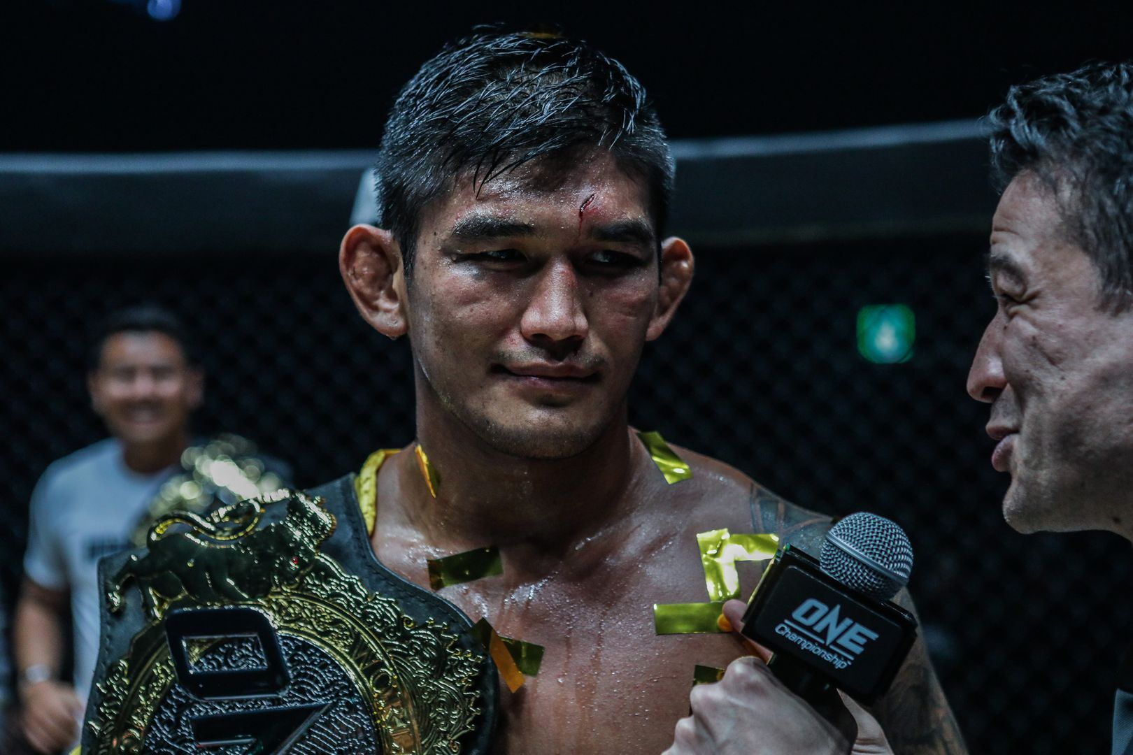 Aung La N Sang talks to Mitch Chilson after his victory over Brandon Vera