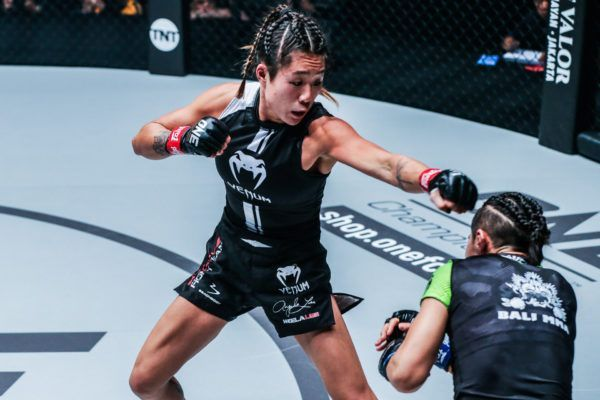 Singaporean-American MMA fighter Angela Lee throws a punch
