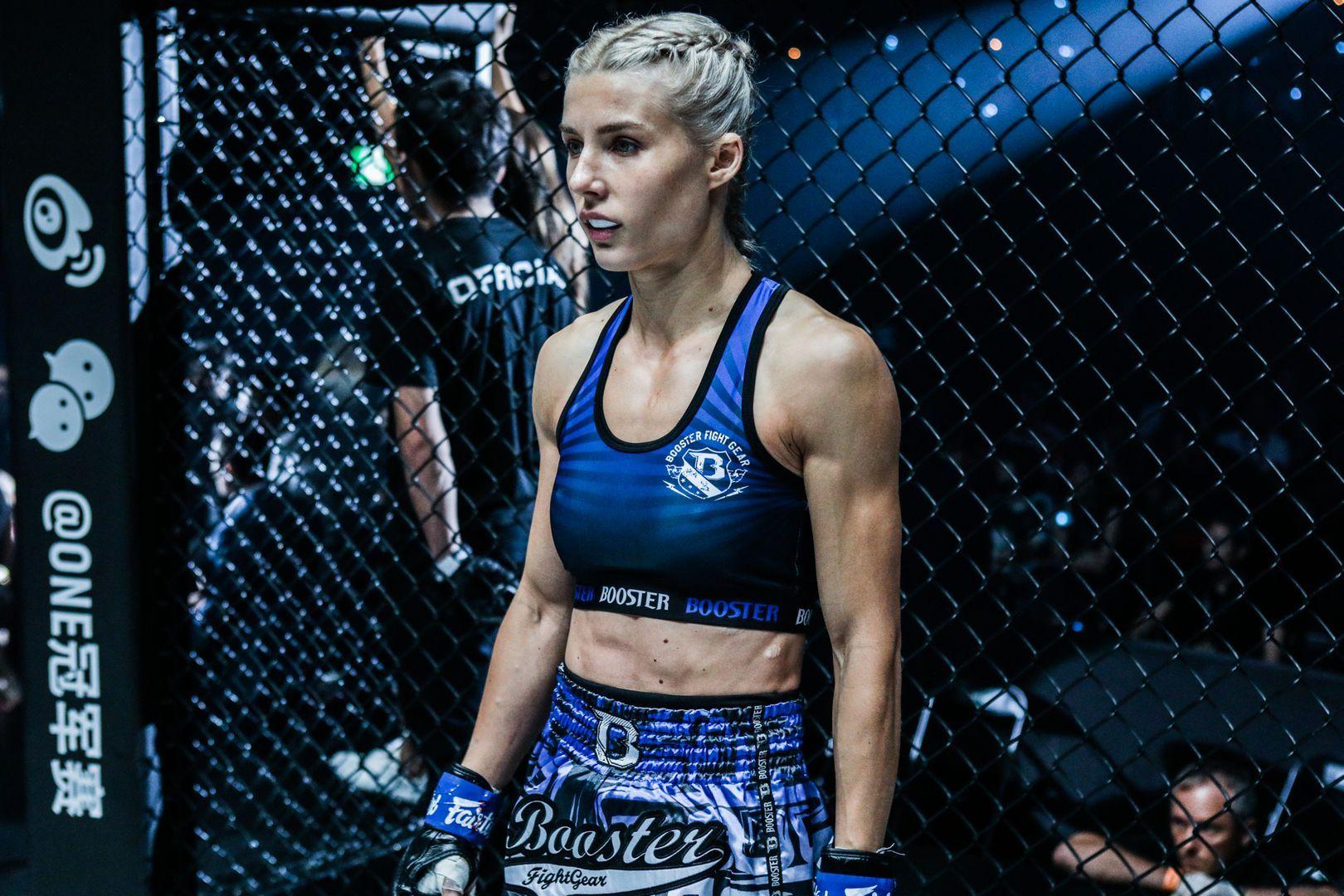 Muay Thai World Champion Ekaterina Vandaryeva stands in the cage