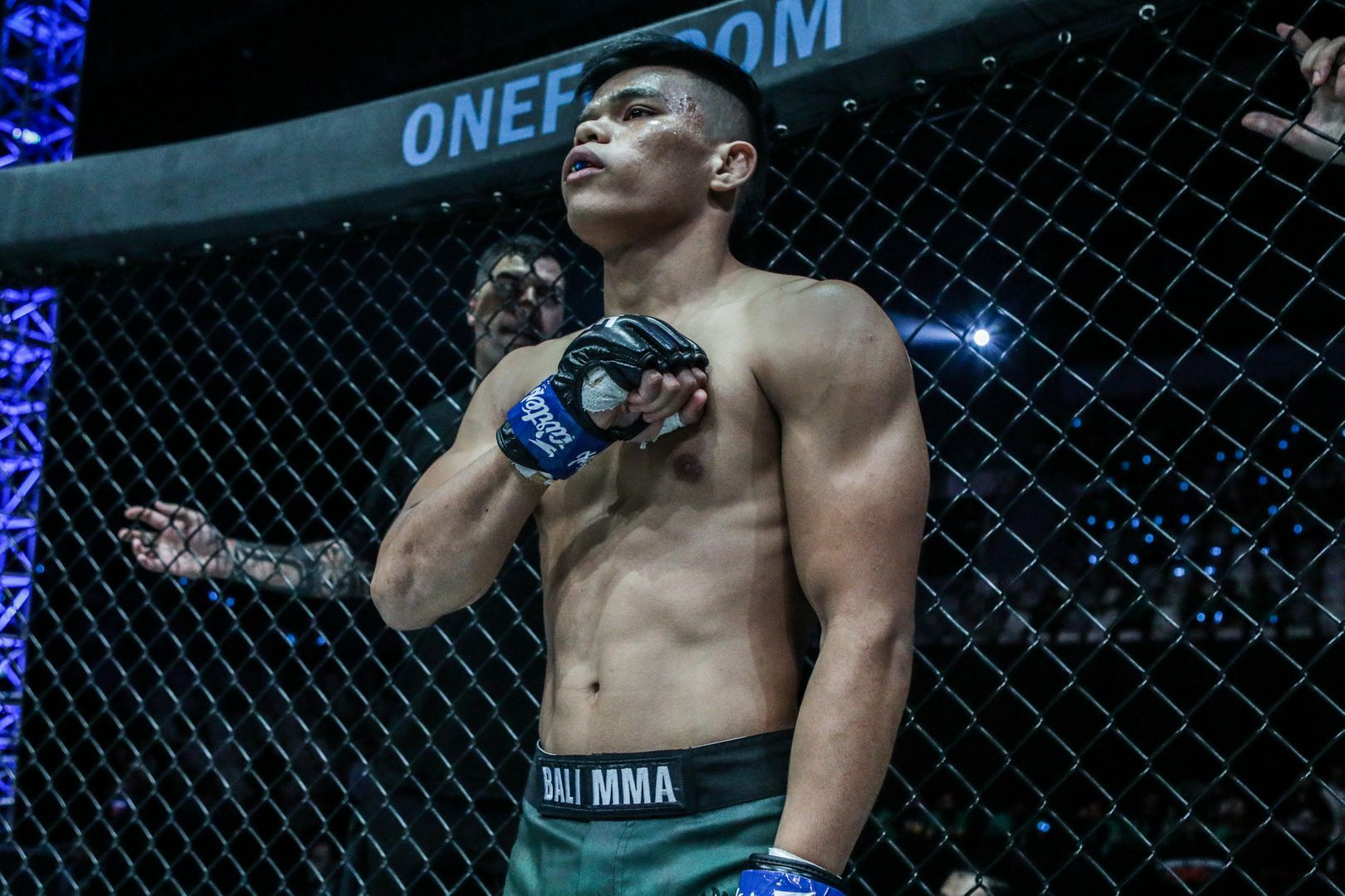 Indonesian MMA fighter Elipitua Siregar stands inside the cage, ready for battle