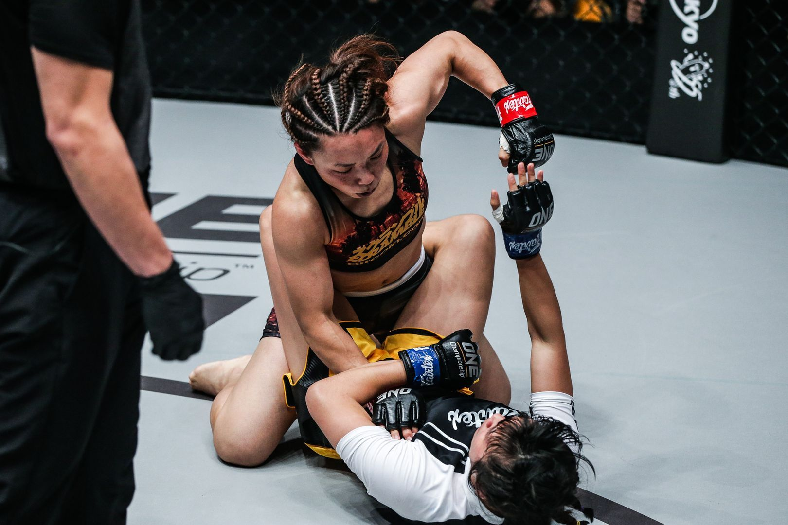 Japanese mixed martial artist Mei Yamaguchi throws ground punches at Jenny Huang