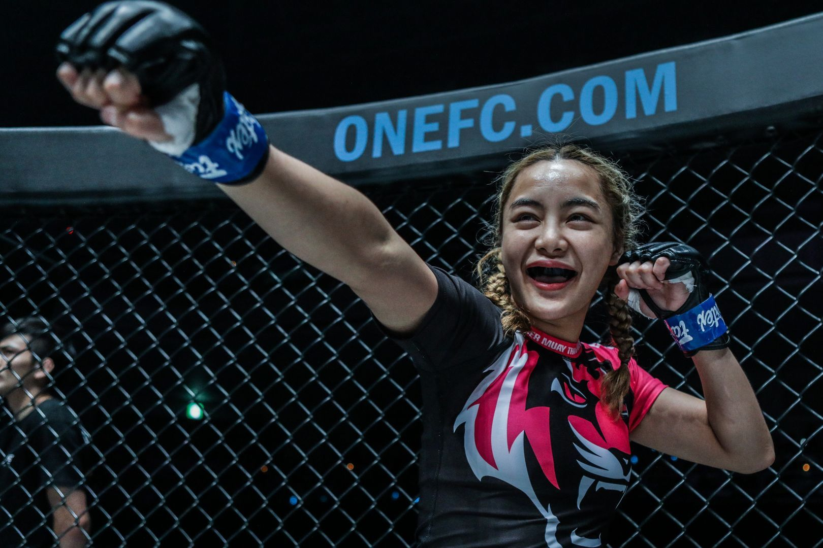 Thai mixed martial arts pioneer flashes her mouthguard in Tokyo, Japan