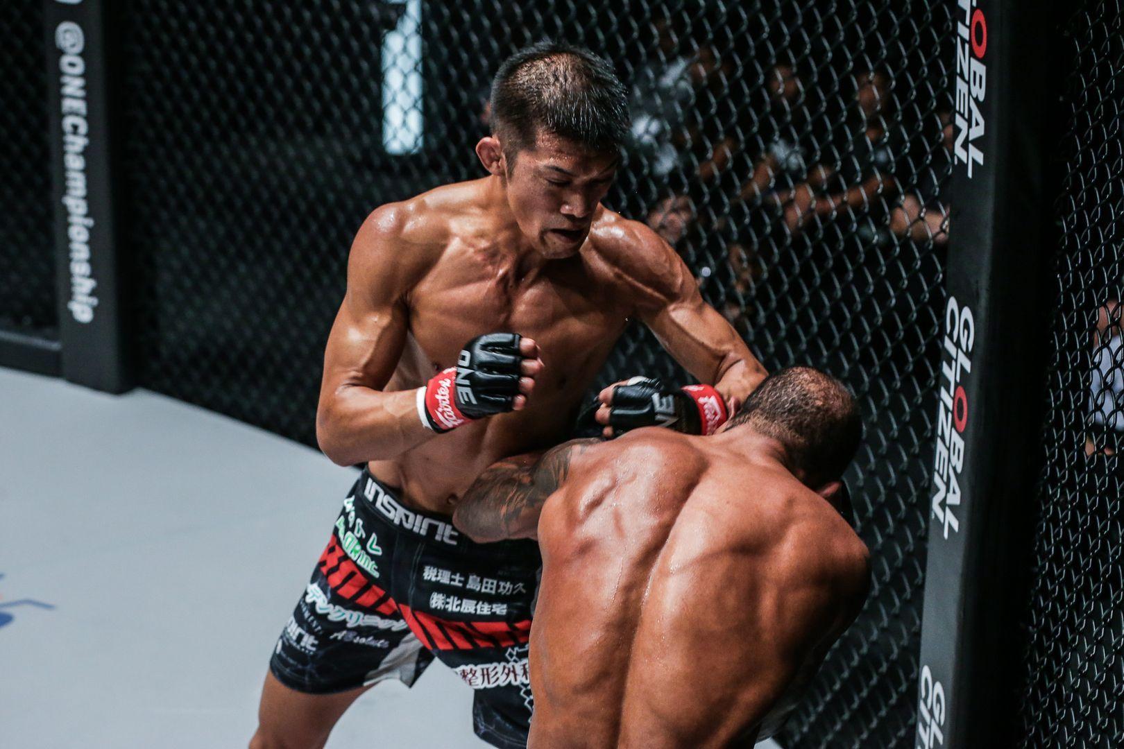 Japanese mixed martial artist Shoko Sato punches Rafael Silva