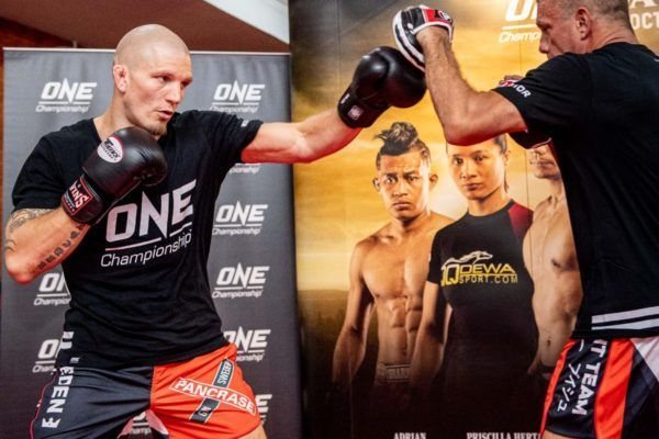 ONE Welterweight World Champion Zebaztian Kadestam at the ONE DAWN OF VALOR open workout with the ONE Championship belt