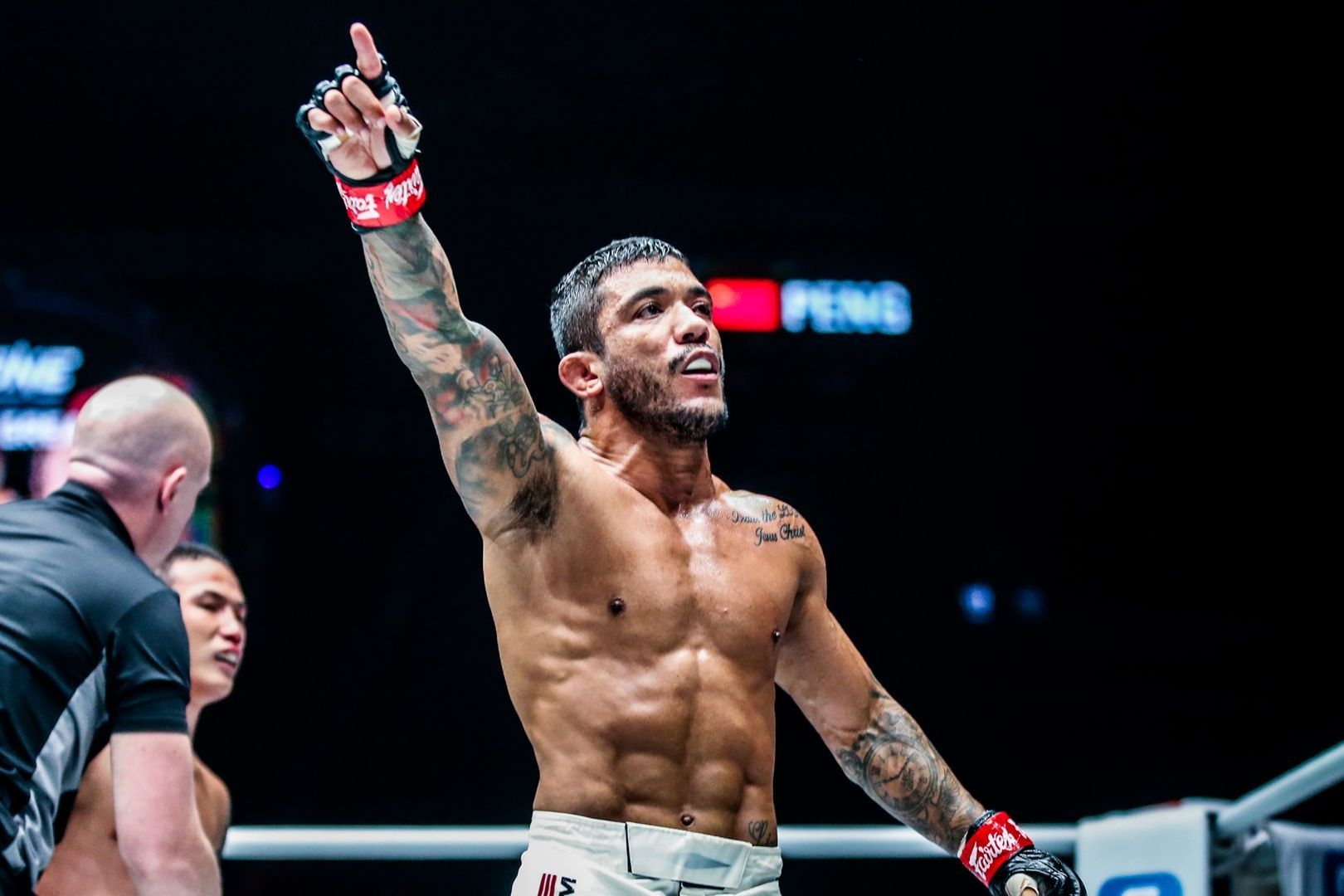 Brazilian mixed martial artist Alex Silva raises his hand in victory in November 2019
