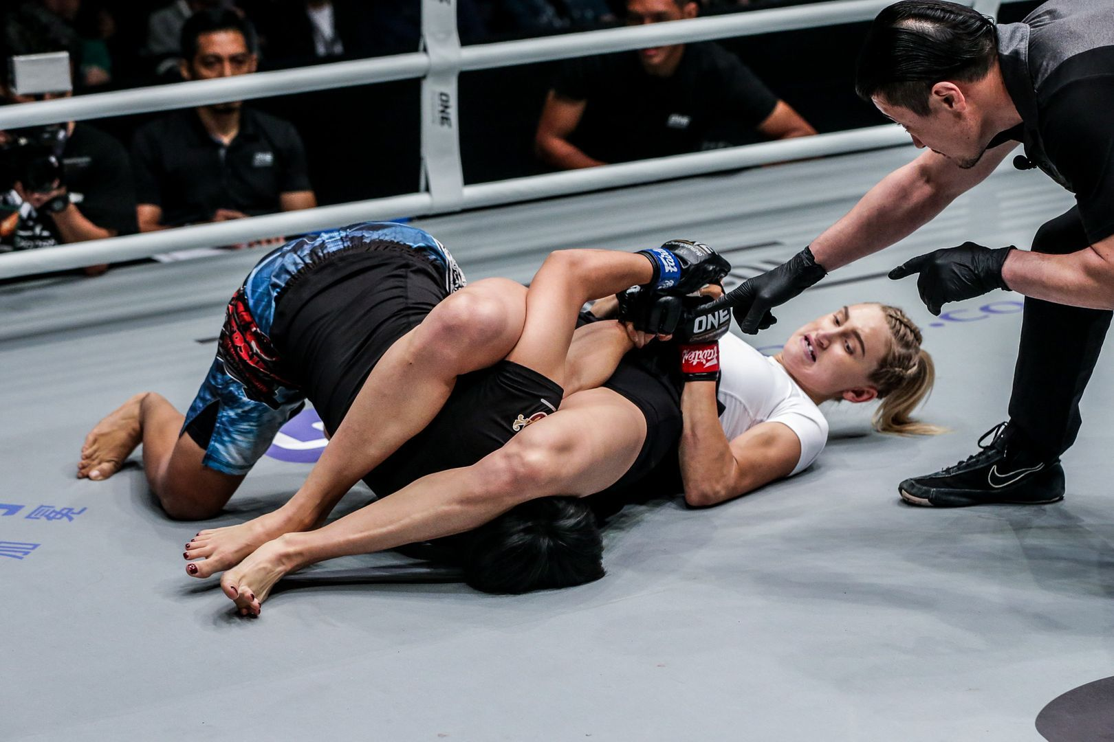 Colbey Northcutt attempts an armbar against Putri Padmi