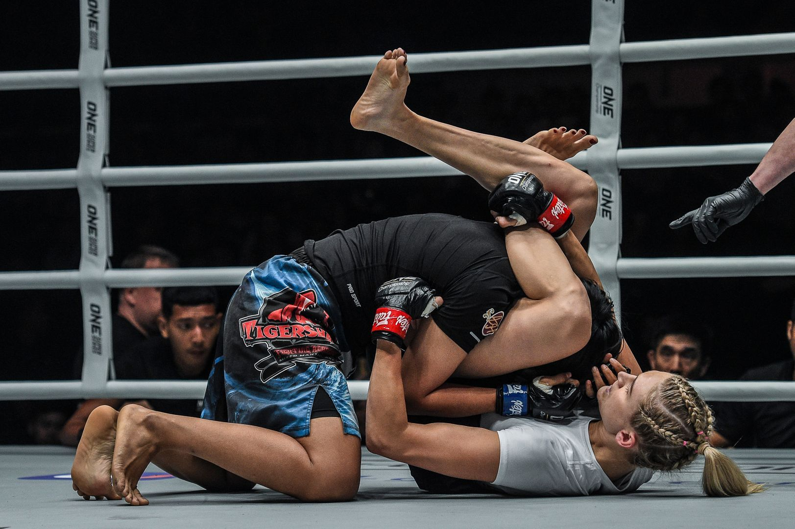 American martial artist Colbey Northcutt sinks in a triangle choke in her ONE debut