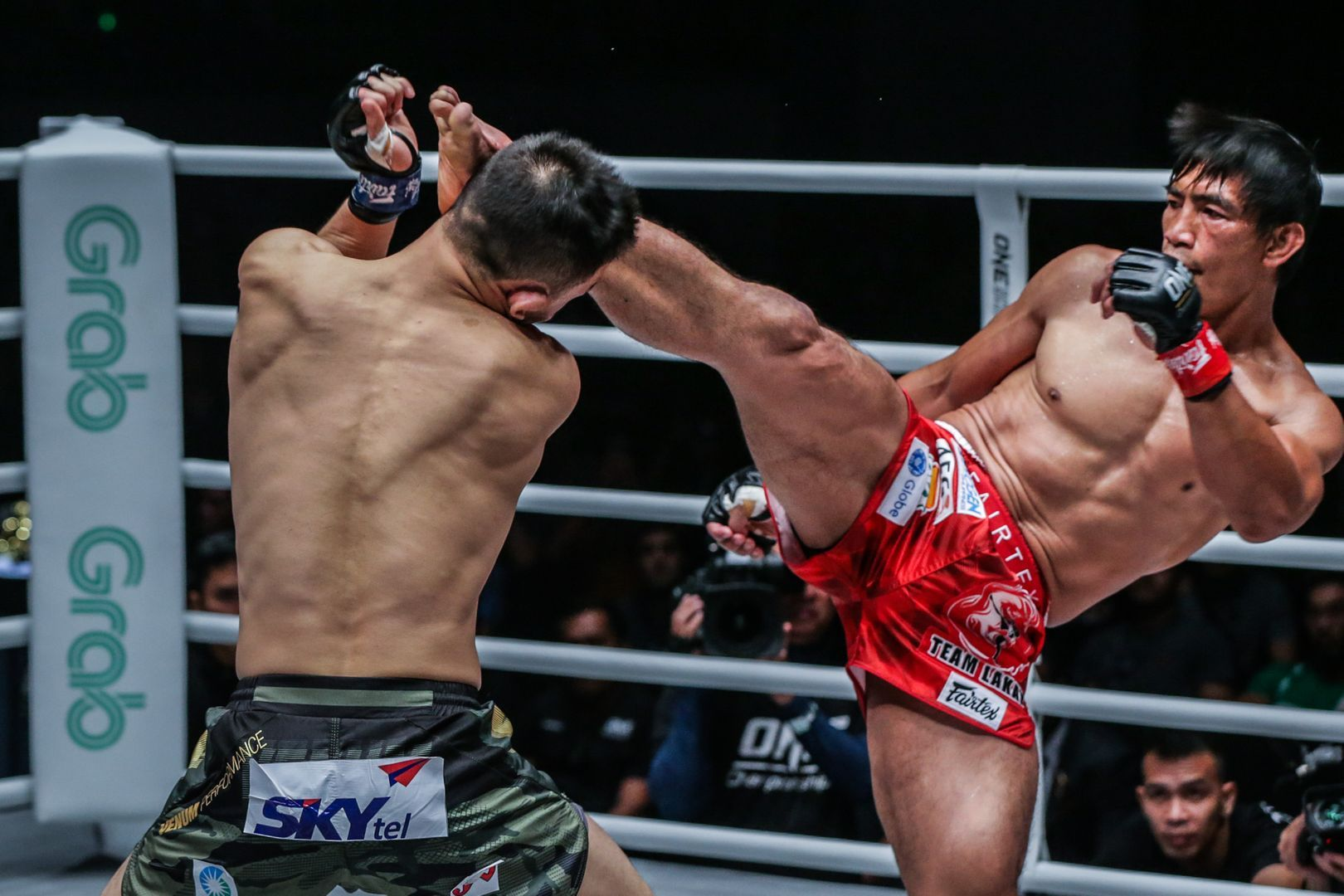 Filipino martial arts icon Eduard Folayang lands a high kick on Amarsanaa Tsogookhuu