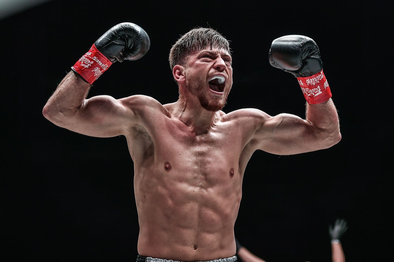 German kickboxer Enriko Kehl flexes hard following his win over Armen Petrosyan