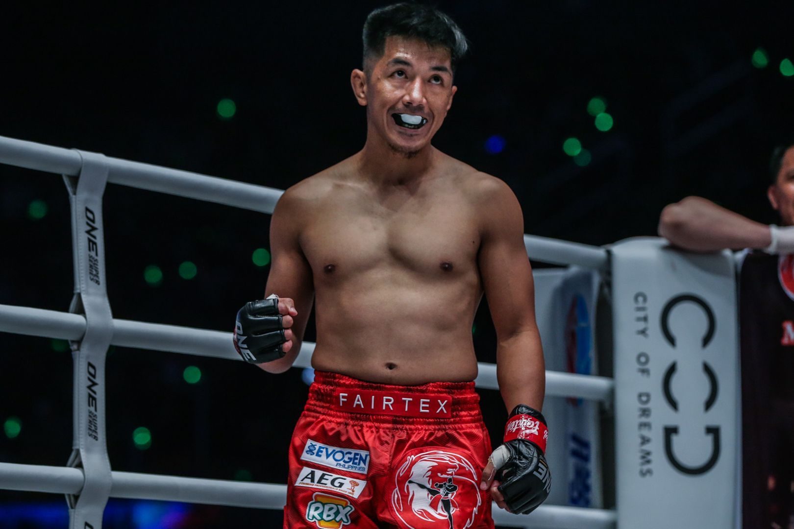 Geje Eustaquio bites his mouthguard in the ring