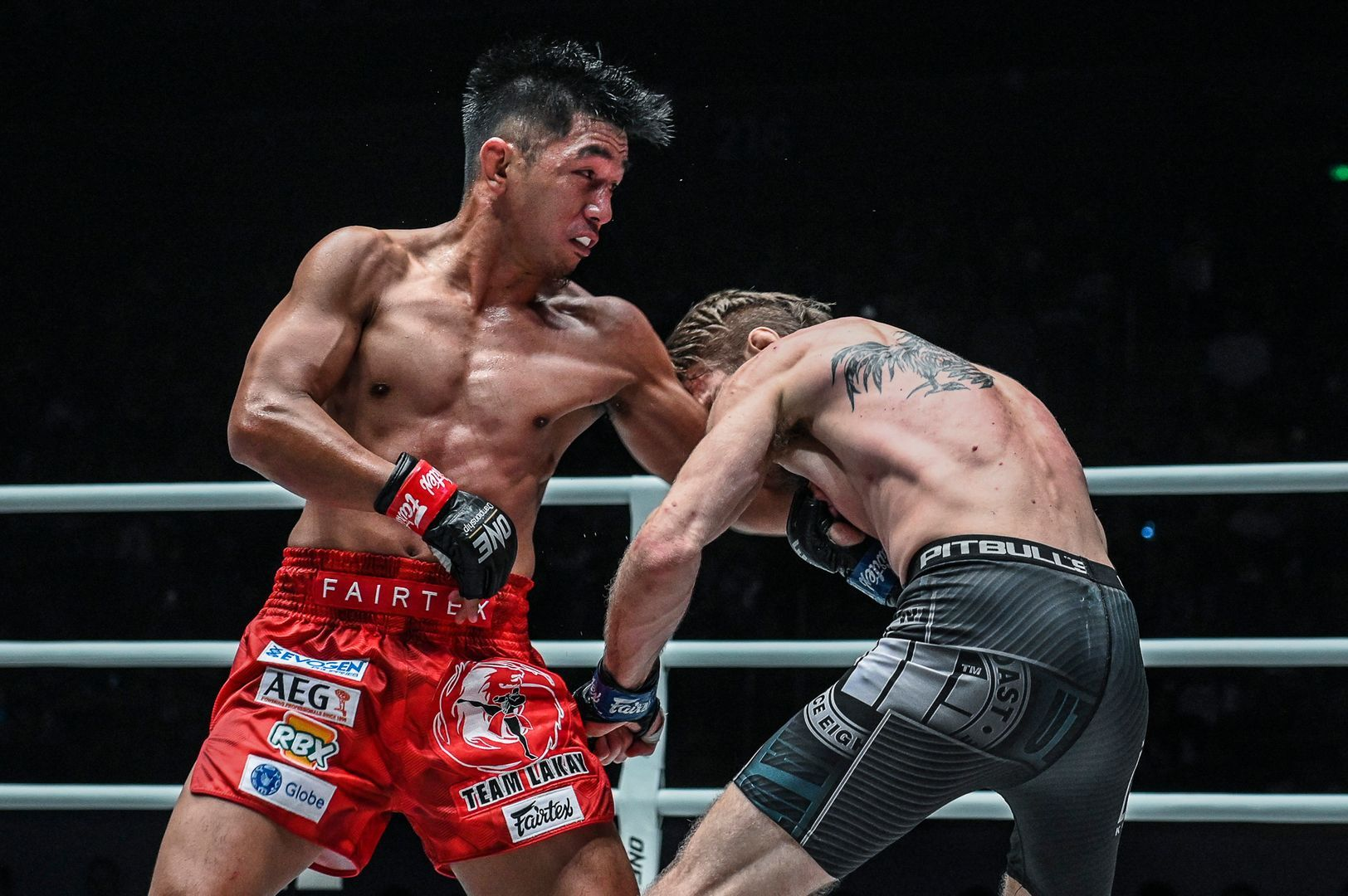 Former ONE Flyweight World Champion Geje Eustaquio punches Toni Tauru