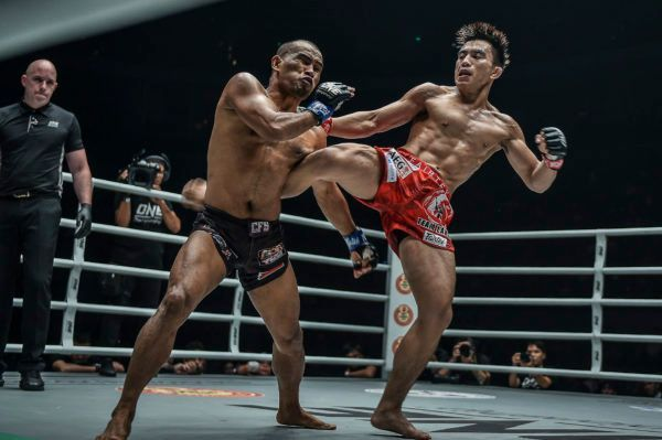 ONE Strawweight World Champion Joshua Pacio connects with a body kick on Rene Catalan