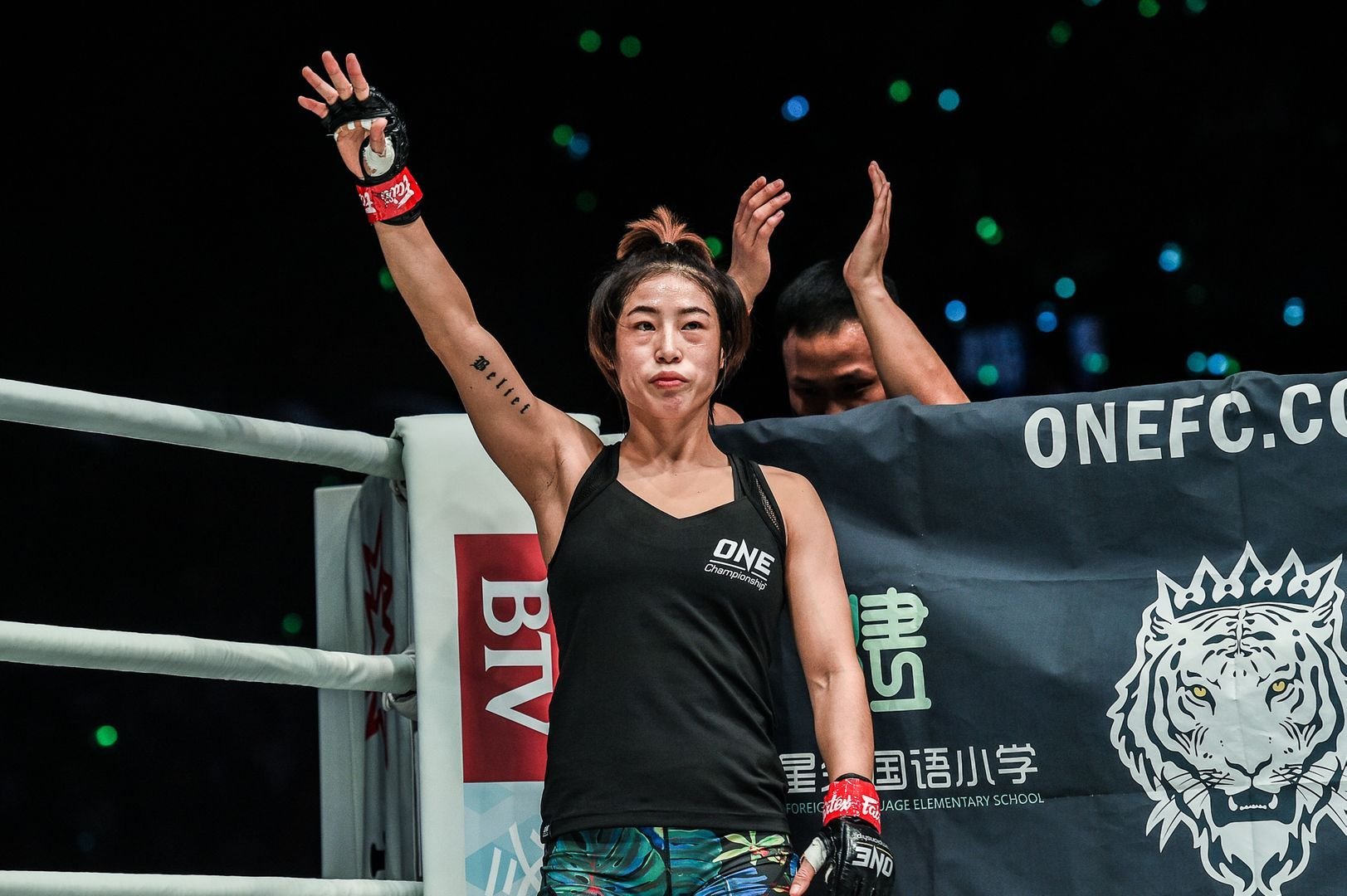 Chinese mixed martial artist Meng Bo raises her arm
