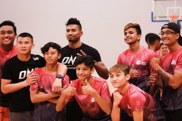 ONE Bantamweight Muay Thai World Champion Nong-O Gaiyanghadao and Amir Khan pose for a picture during a workshop