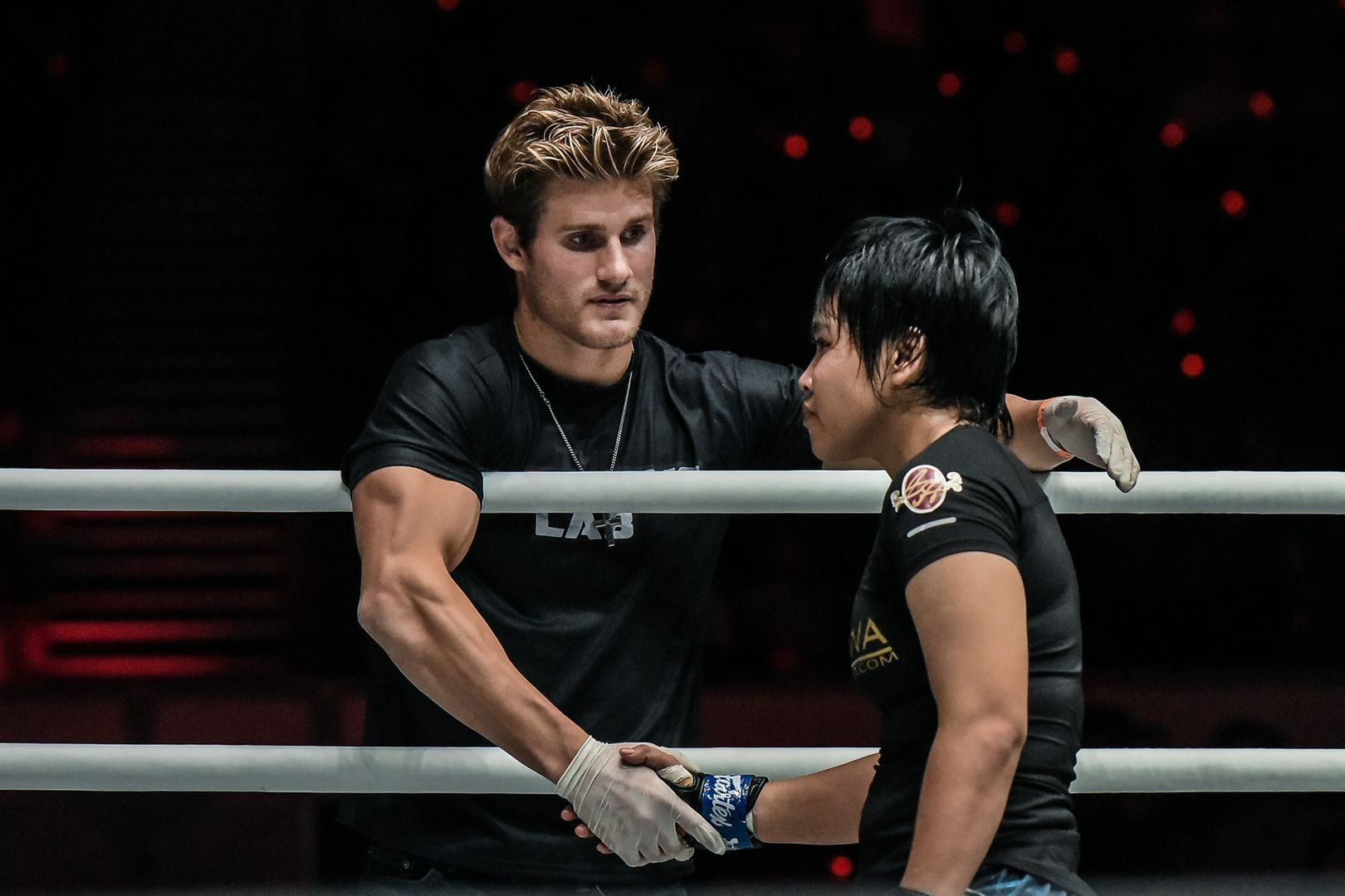 Sage Northcutt shakes Putri Padmi's hand after his sister, Colbey Northcutt, defeats her