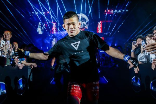 Japanese mixed martial artist Shuya Kamikubo enters the arena