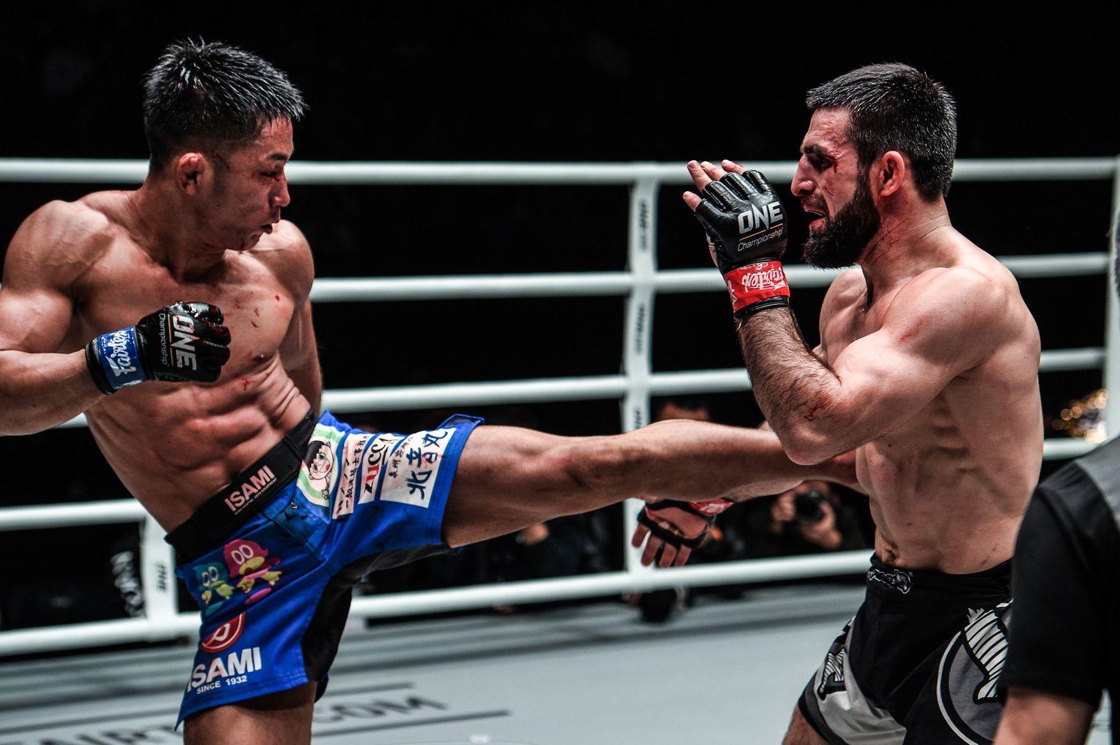 Daichi Takenaka throws a kick as Yusup Saadulaev
