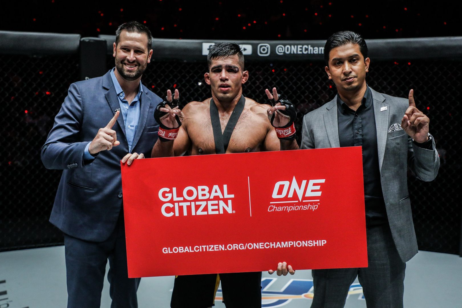 ONE Championship executives stand with Agilan Thani following his win in Kuala Lumpur, Malaysia