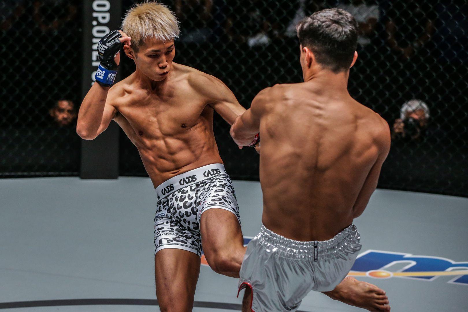 Japanese Muay Thai fighter Taiki Naito kicks Rui Botelho