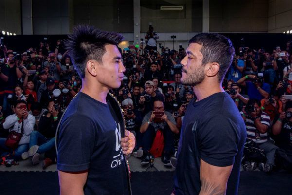 ONE Strawweight World Champion Joshua Pacio faces off with Alex Silva at the ONE: FIRE & FURY Press Conference