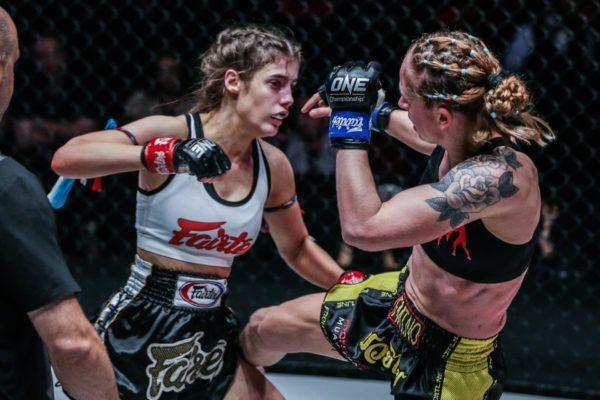 Australian Muay Thai striker Alma Juniku kicks Anne Line Hogstad