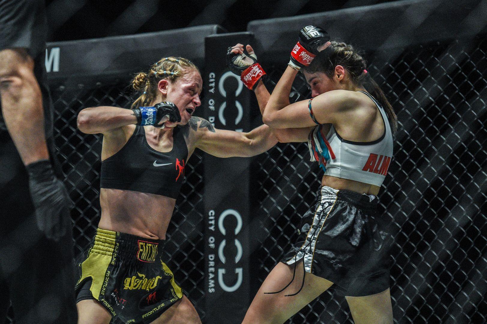 Norway's Anne Line Hogstad punches Australia's Alma Juniku