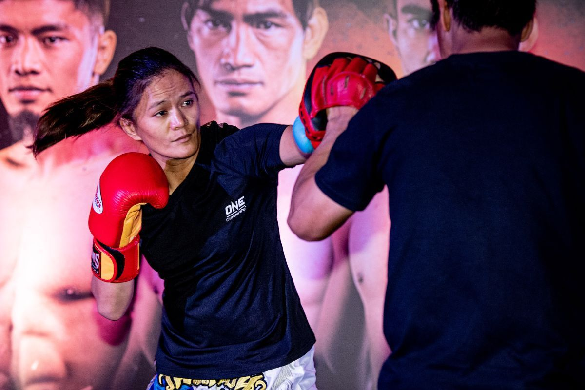 Team Lakay's Gina Iniong hits the focus mitts at an open workout