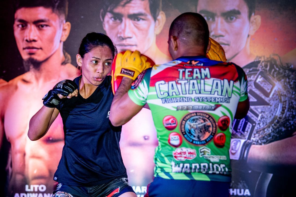 Jomary Torres hits pads with Rene Catalan at the ONE FIRE & FURY Open Workout