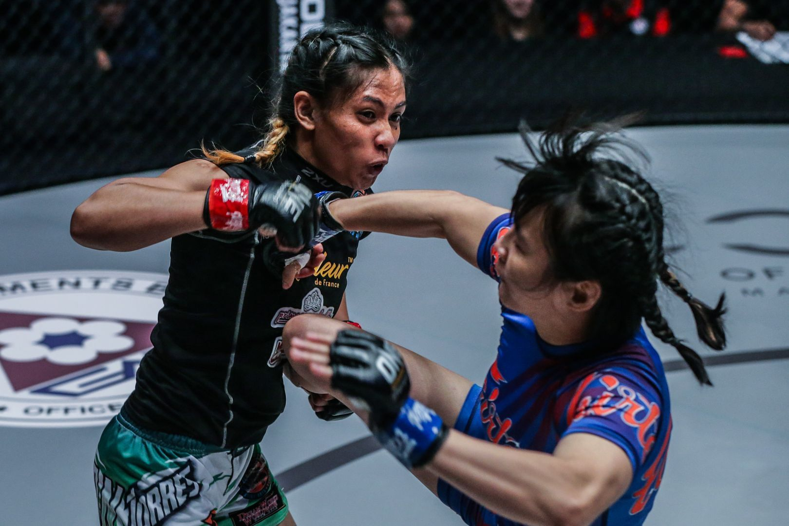 The Philippines' Jomary Torres squares off against China's Jenny Huang