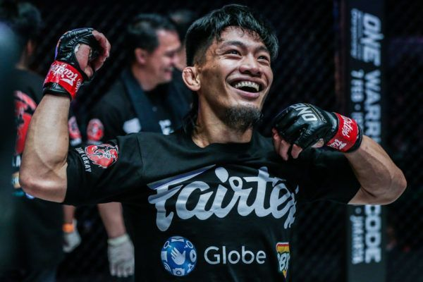 Team Lakay's Lito Adiwang celebrates his victory over Pongsiri Mitsatit