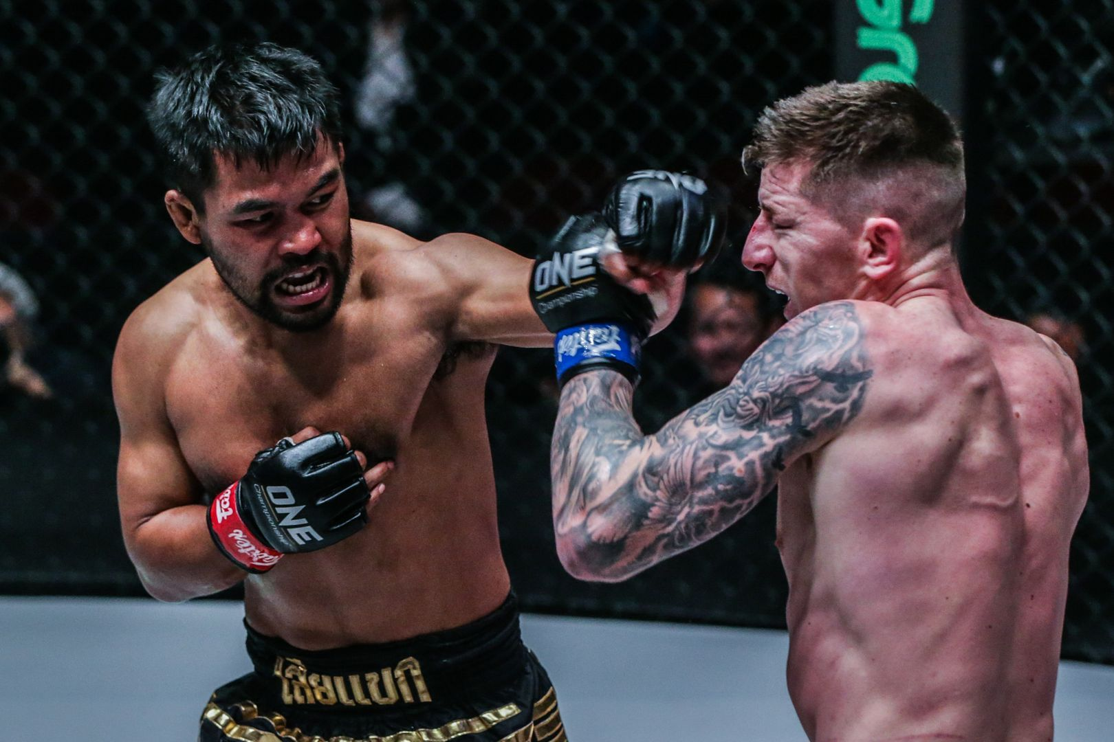 Thailand's Rodlek PK.Saenchaimuaythaigym and Scotland's Chris Shaw compete in ONE Championship