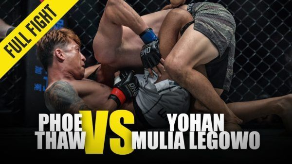 Phoe Thaw attempts a guillotine choke on Yohan Mulia Legowo at ONE: REIGN OF VALOR.