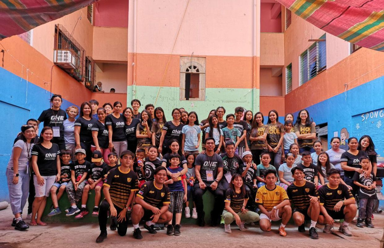 A group shot featuring ONE Championship and those who went to Gawad Kalinga in Manila