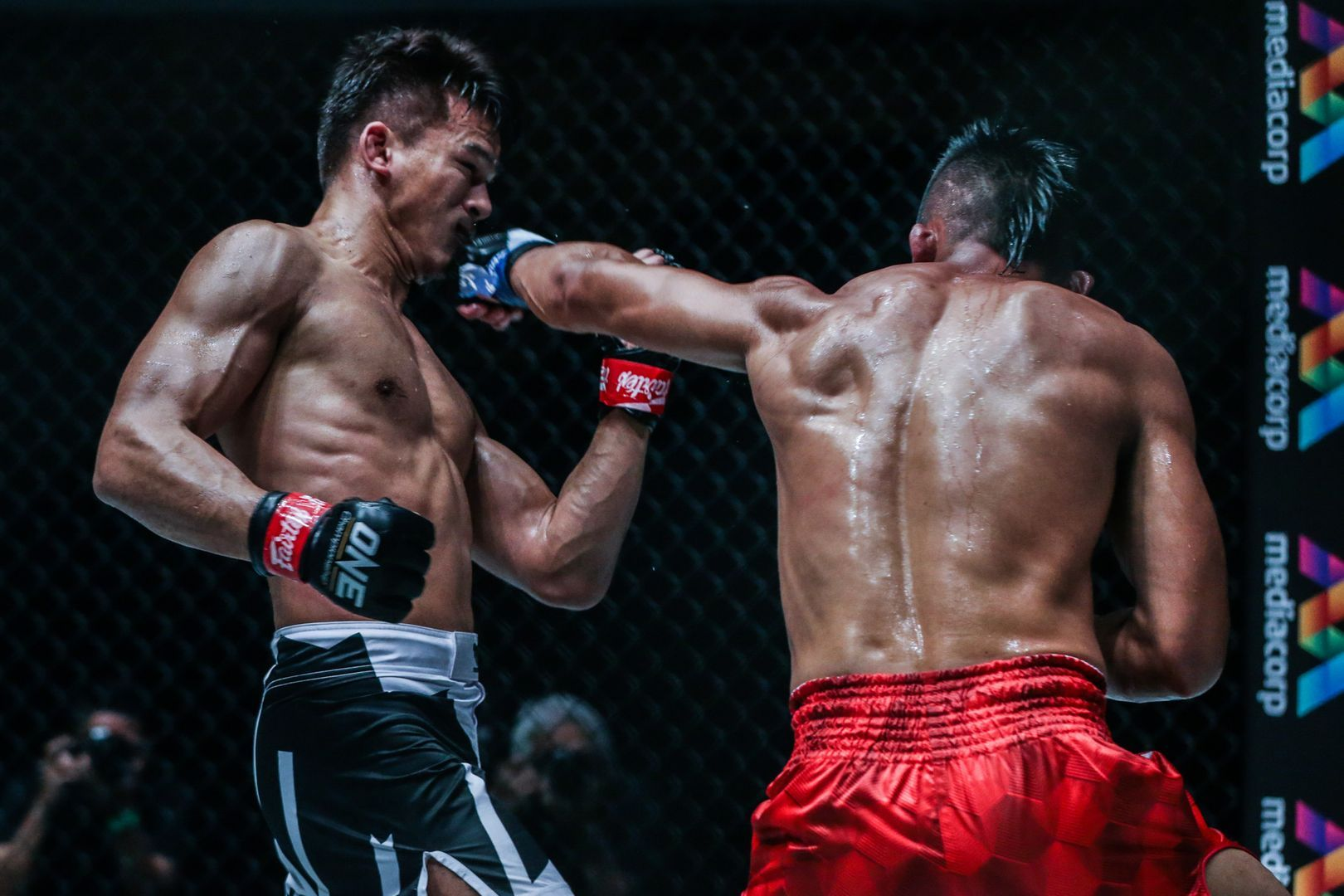 Honorio BAnario lands a punch on Shannon Wiratchai