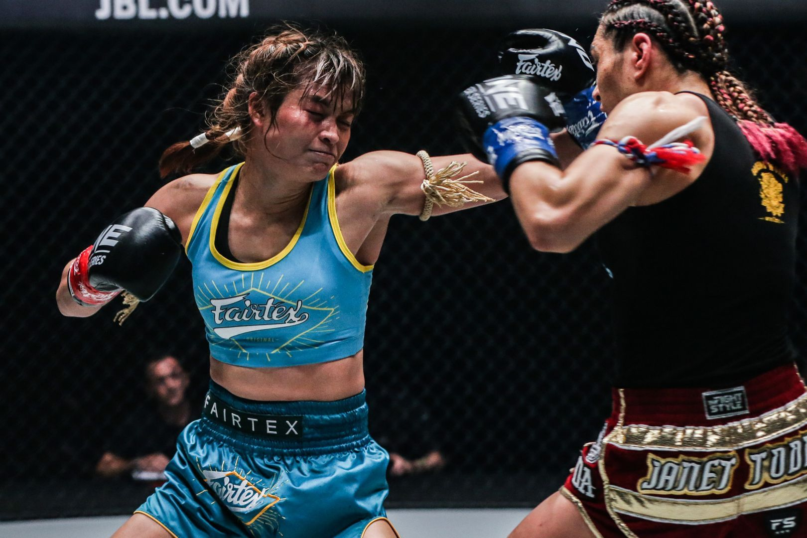 Stamp Fairtex Hits Janet Todd With An Overhand Left