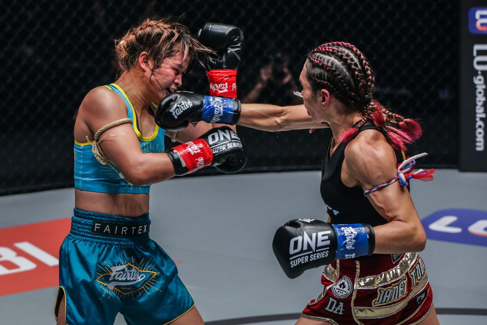 Janet Todd lands a punch on Stamp Fairtex