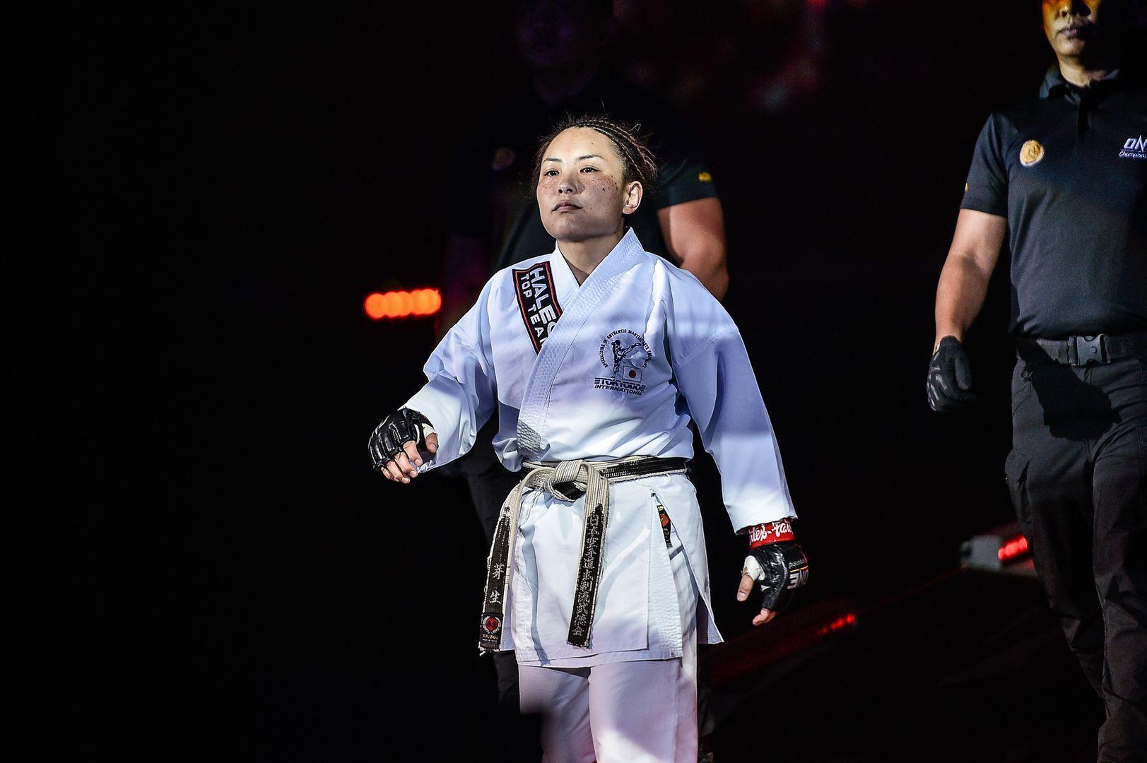 Mei Yamaguchi walks out in her karate gi