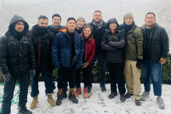 The staff of Rich Franklin's ONE Warrior Series stand in the cold of Pakistan
