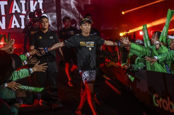Japanese Muay Thai specialist Taiki Naito walks to the ring