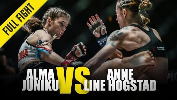 Aussie Alma Juniku lands a kick to the body of Norway's Anne Line Hogstad at ONE: FIRE & FURY.