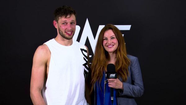 Miesha Tate speaks with co-main event victor Reinier De Ridder after his unanimous decision win over Leandro Ataides.