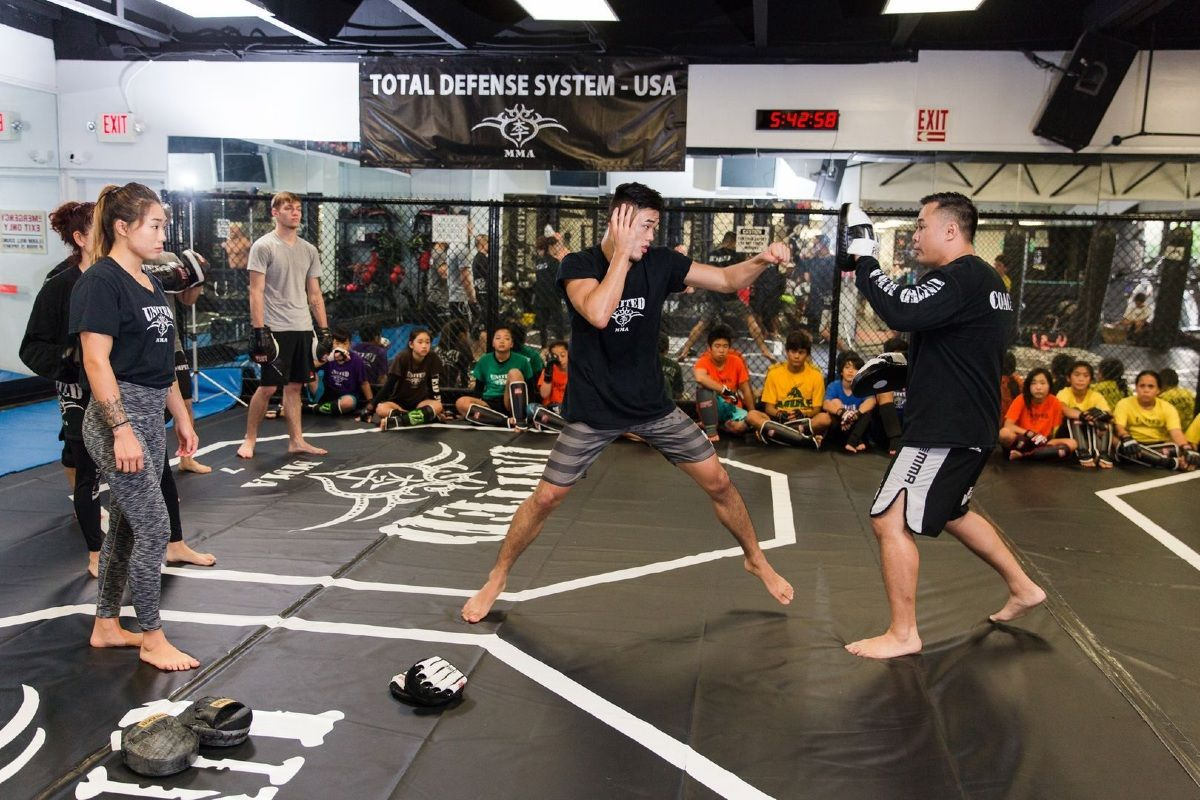 Christian Lee demonstrates a boxing technique at United MMA in Hawaii