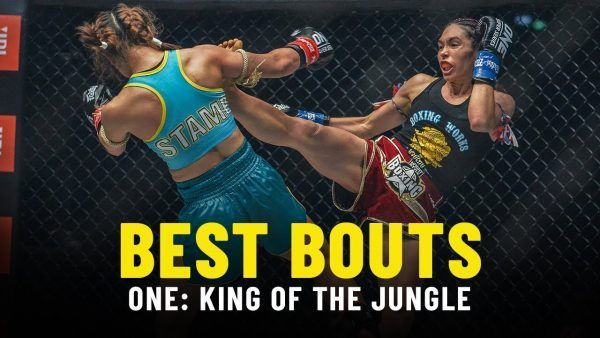 Janet Todd scores with a body kick during her meeting with Stamp Fairtex in the ONE: KING OF THE JUNGLE main event.