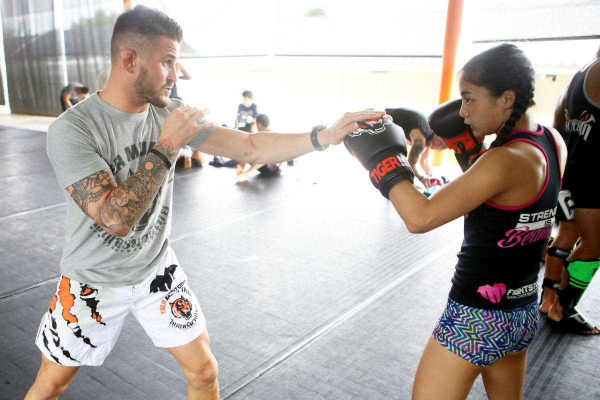 George Hickman teaches Rika Ishige technique at Tiger Muay Thai
