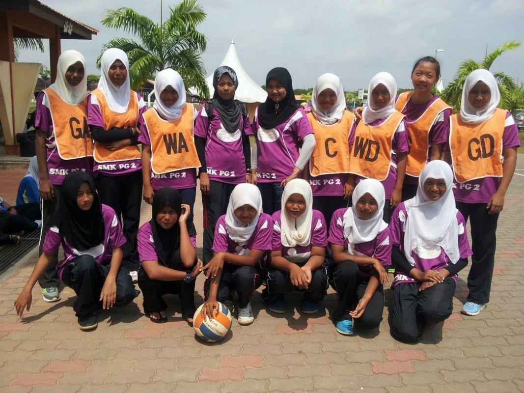 Malaysian atomweight mixed martial artist Jihin Radzuan and her school netball team