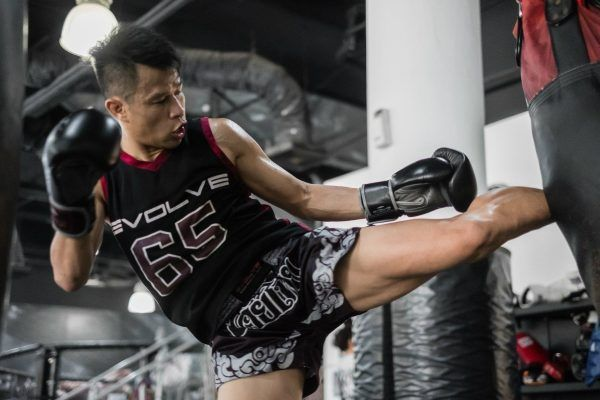 Multiple-time Muay Thai World Champion Sagetdao Petpayathai kicks a heavy bag at Evolve in Singapore