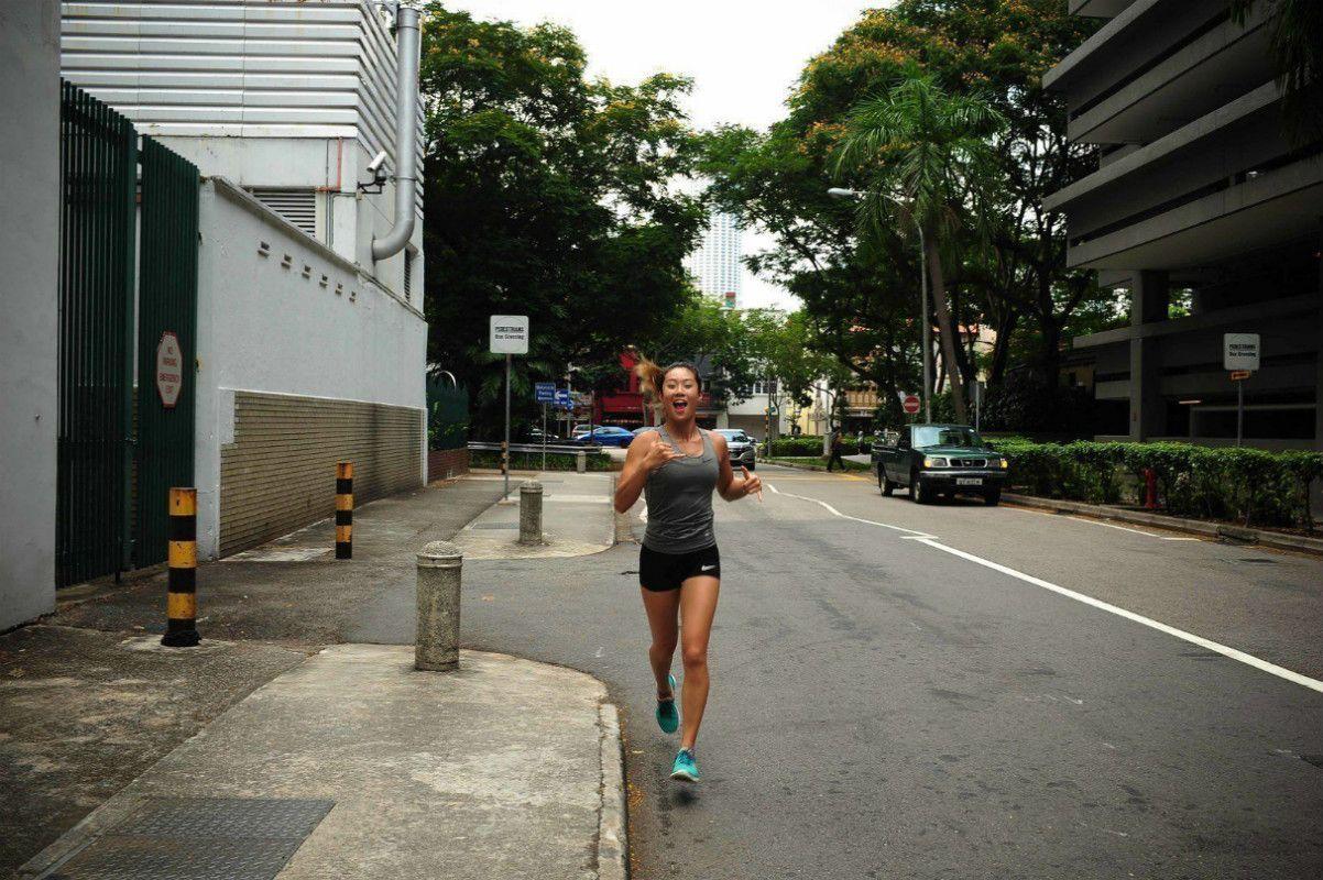 ONE Women's Atomweight World Champion Angela Lee runs