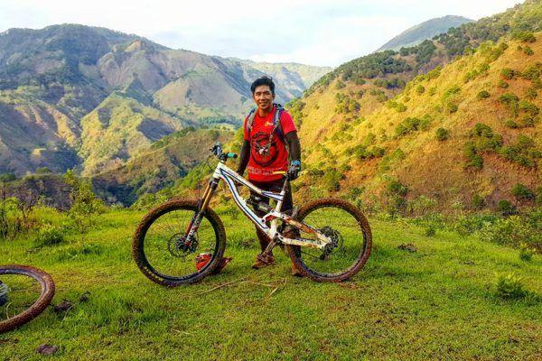 Filipino mixed martial artist Geje Eustaquio rides his bike in the mountains