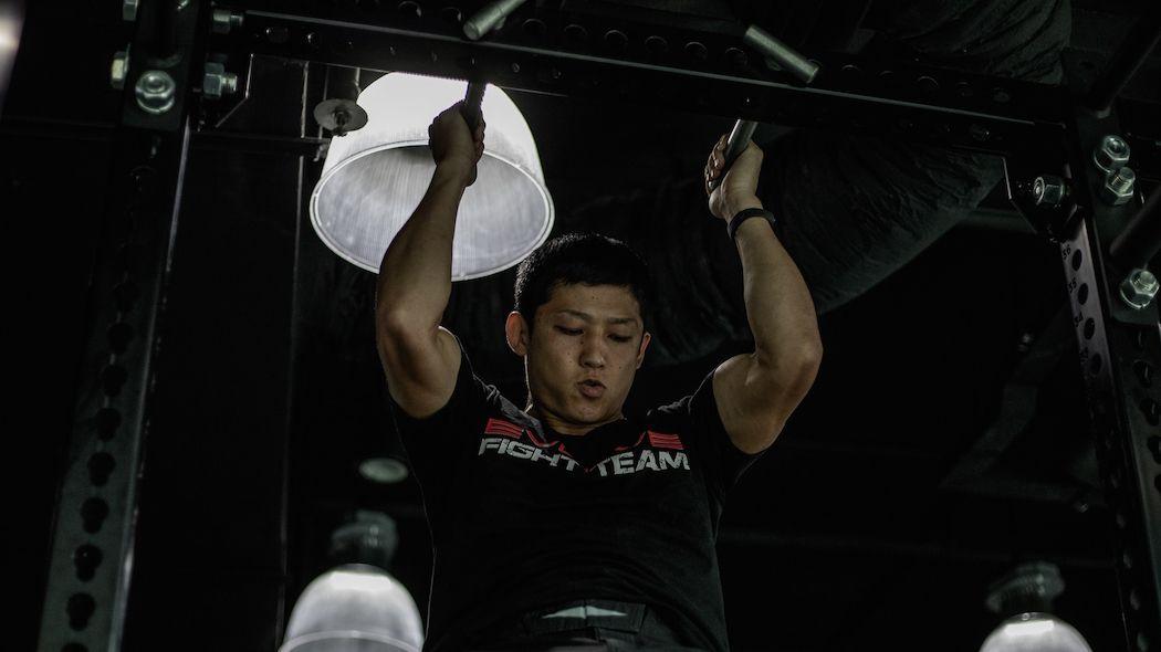 Japanese kickboxing star Hiroki Akimoto performs a pull-up